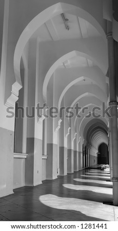 arches in the shadow - stock photo