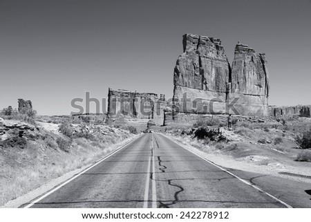 Arches National Park in Utah, USA. Famous Arches scenic drive road. Black and white tone - retro monochrome color style. - stock photo