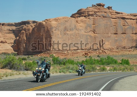 ARCHES NATIONAL PARK UTAH,USA - MAY 07:Harley-Davidson Riders at Arches National Park on May 07, 2009 in Utah, USA.Arches National Park is one of the most beautiful, and famous national parks in Utah. - stock photo