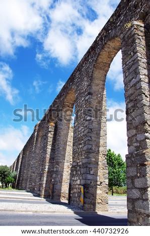 Arches of aqueduct, Evora, Portugal - stock photo