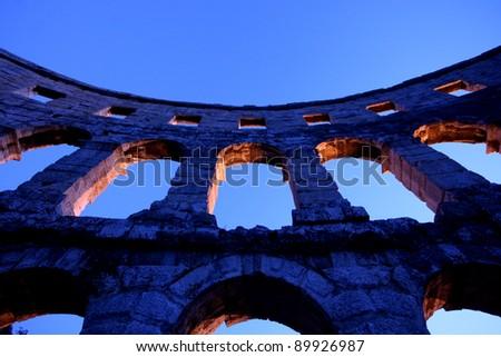 Arches of the Roman amphitheatre - stock photo