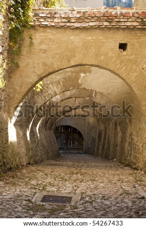 arches over passage entrance at fortified church in Biertan Transylvania Romania - stock photo