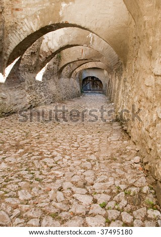 arches over paved entrance at Biertan fortified church in Transylvania Romania - stock photo