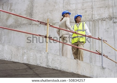 Architect and construction manager on site - stock photo