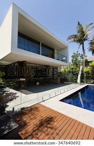 Architect designed contemporary Australian home outdoor area with deck and pool - stock photo