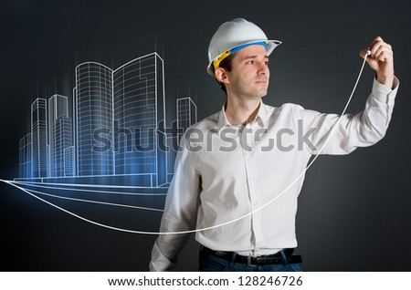 Architect drawing an urban city blueprint - stock photo