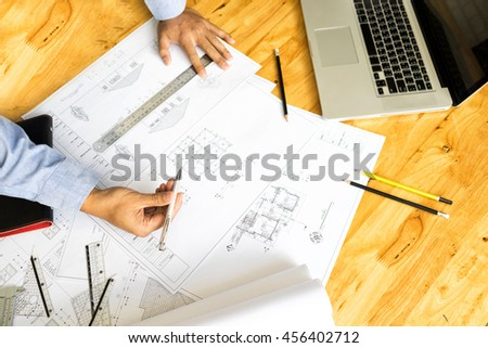 Hands engineer drawing on architectural project stock for Architectural engineering concepts