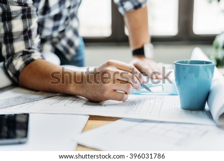 Architect drawing on architectural project - stock photo