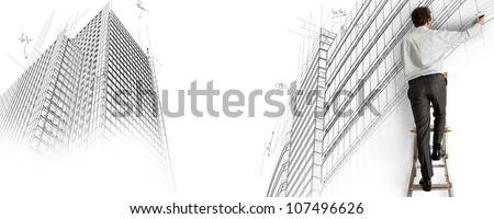 Architect draws a project on a staircase - stock photo