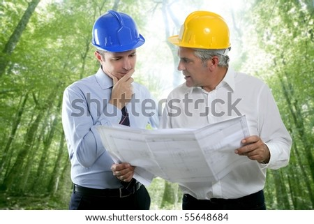 architect engineer two expertise team plan talking hardhat forest jungle trees [Photo Illustration] - stock photo