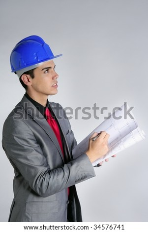 Architect engineer with blue hardhat and suit isolated on gray - stock photo