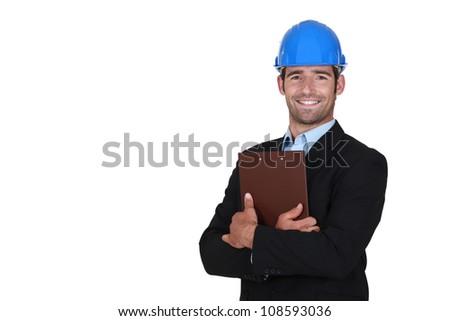Architect holding clip-board - stock photo
