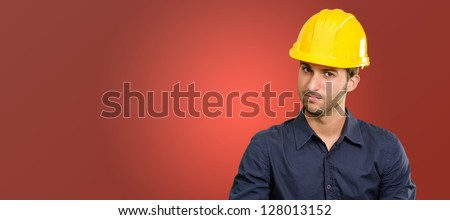 Architect Holding Clipboard And Pen On Red Background