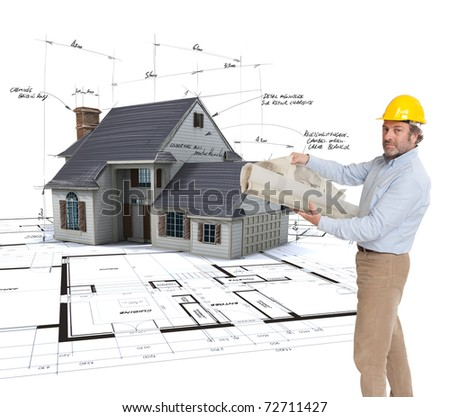 Architect holding  plans with a House mock-up on top of blueprints with pen notes and corrections - stock photo