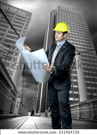 Architect in protective helmet