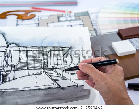 Architect /interior's hand drawing illustration of home renovation with material sample - stock photo