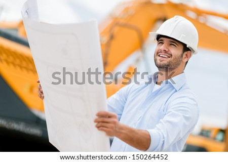 Architect looking at blueprints in a building site   - stock photo