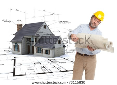 Architect looking at his plans with a House mock-up on top of blueprints with pen notes and corrections - stock photo