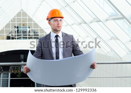 architect looking comparing housing project with building - stock photo