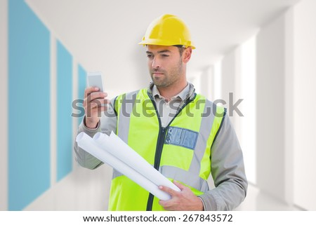Architect on the phone against modern blue and white room