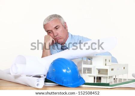 Architect overwhelmed - stock photo