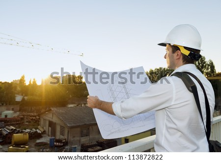 Architect planing a future project - stock photo
