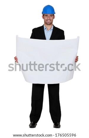 Architect posing with blueprints - stock photo