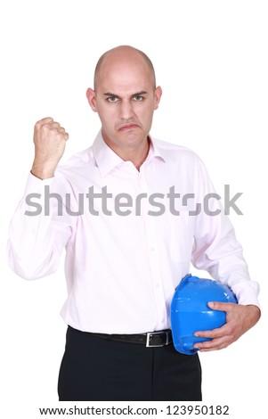Architect raising his fist - stock photo
