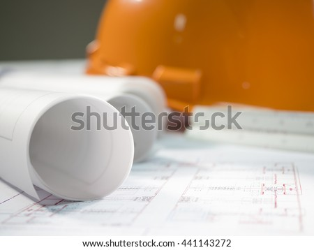 Architect rolls and plans (Selective focus) - stock photo