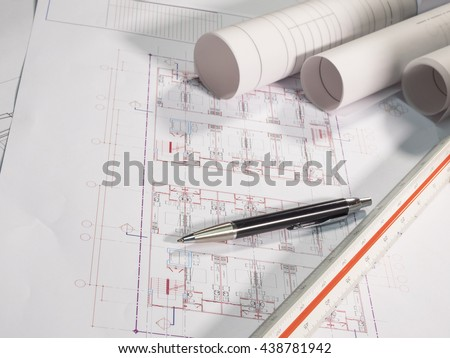 Architect rolls and plans, technical project drawing and pen on table (Selective focus) - stock photo