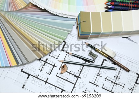 Architects And Designers Desk During Work With Technical Drawing Color Sample Catalog Pencils