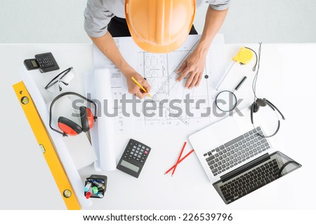 Architect sketching a construction project, view from the top - stock photo
