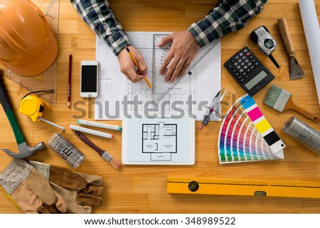 Architect sketching construction project, view from the top - stock photo