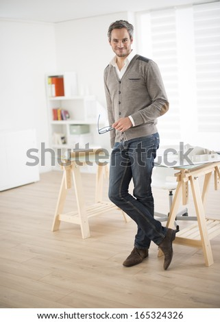 architect standing in front of his office - stock photo