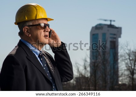 Architect who supervise the work on the construction site - stock photo