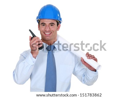 Architect with a walkie-talkie - stock photo