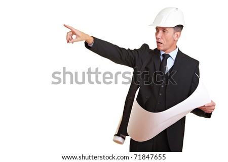 Architect with white hard hat point to the left - stock photo
