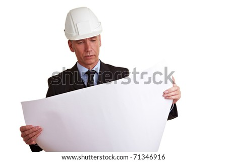 Architect with white helmet looking at construction prints - stock photo