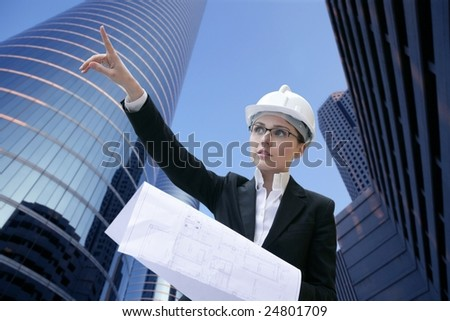 architect woman working outdoor with modern buildings [Photo Illustration] - stock photo
