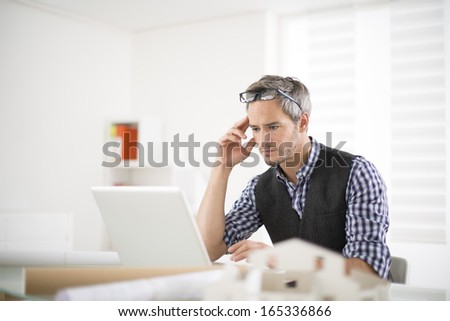 architect working at his laptop on the office
