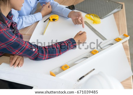 Architect working blueprint on table woodengineer stock photo architect working blueprint on table wood inspective in workplace architectural project blueprints malvernweather Gallery