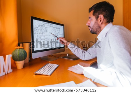 Architect working in office with his computer