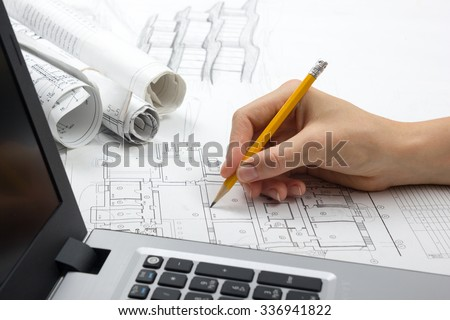 Architect working on blueprint architects workplace stock photo architect working on blueprint architects workplace architectural project blueprints laptop construction malvernweather Choice Image