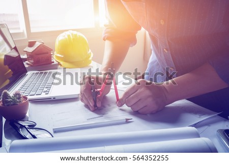 Architect working on blueprint architects workplace stock photo architect working on blueprint architects workplace architectural project blueprints ruler calculator malvernweather Gallery