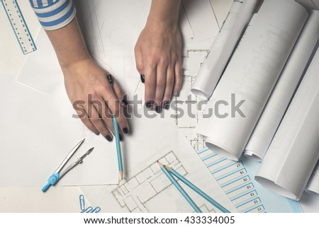 Architect working on blueprint architects workplace stock photo architect working on blueprint architects workplace architectural project blueprints ruler and divider malvernweather Image collections