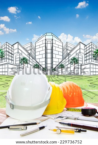 architect working table with writing tool  safety helmet and perspective plan drawing of new building construction project for land development and real estate design - stock photo