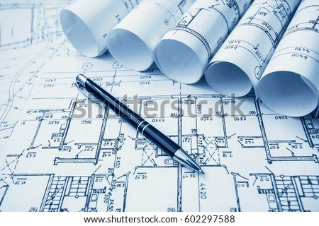 Architect workplace architectural project blueprints blueprint foto architect workplace architectural project blueprints blueprint rolls on wooden desk table construction malvernweather Gallery