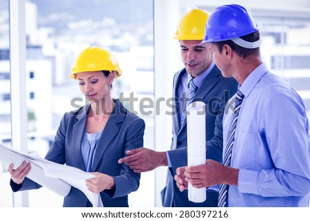 Architects discussing their plans in the office - stock photo