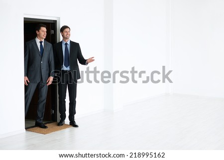 Architects in an empty room - stock photo