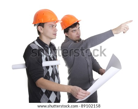Architects looking on a blueprints